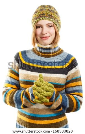 Beautiful young smiling woman in colored striped sweater, green knitted hat and gloves standing isolated on white background - stock photo