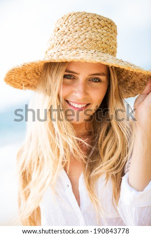 Beautiful young smiling woman outdoors portrait. Soft warm sunny colors - stock photo