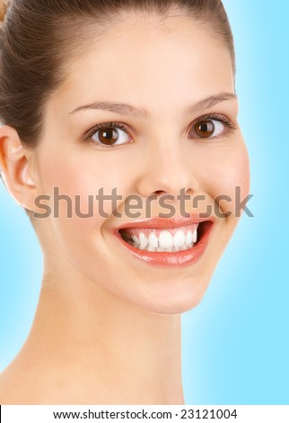 Beautiful young smiling woman. Over blue background