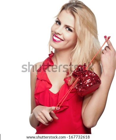 Beautiful young smiling woman with blonde hair and with gift
