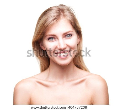 Beautiful young smiling woman with clean fresh skin - stock photo