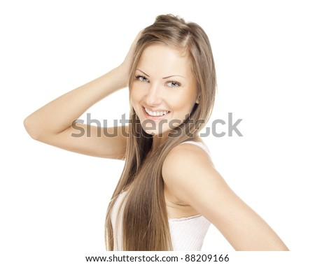 beautiful young smiling woman with long hair - stock photo