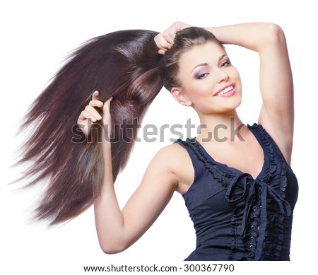 Beautiful young smiling woman with long hair on white background - stock photo