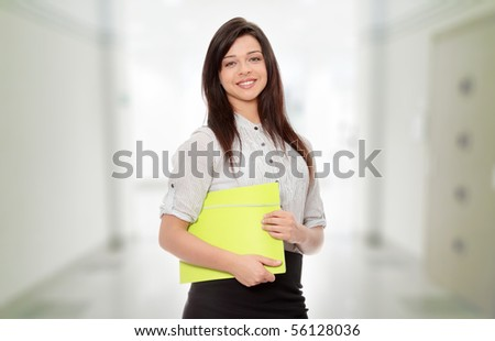 Beautiful young smiling woman with note pad. - stock photo