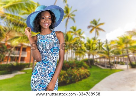 Beautiful young South African woman in blue - stock photo