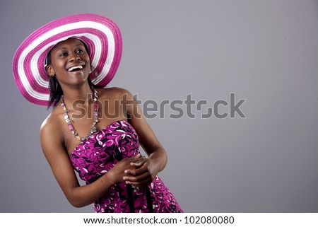 Beautiful young South African woman in bright colours - stock photo