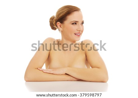 Beautiful young spa woman by a desk.