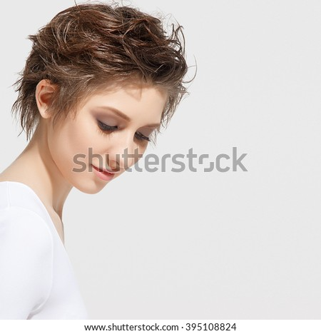 Beautiful young spa woman with short hair portrait. Attractive girl Face with perfect Clean Fresh Skin close up. Beauty model. Youth and Skin Care Concept - stock photo