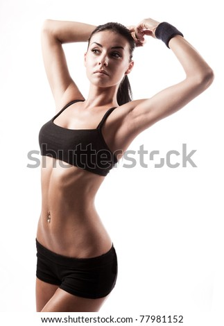 beautiful young sporty muscular  woman, isolated against white background