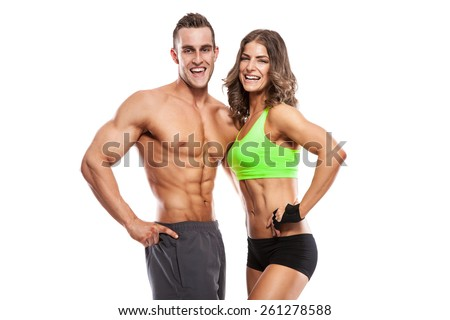 beautiful young sporty sexy couple  isolated over white background - stock photo