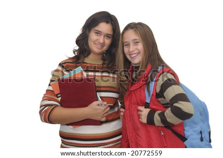 Beautiful young student girls posing against a white background