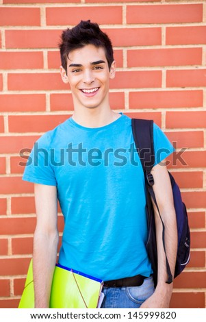 Beautiful young student in campus - stock photo