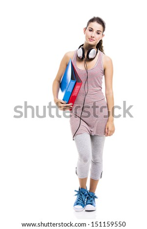 Beautiful young student with books and headphones, isolated over a white background - stock photo