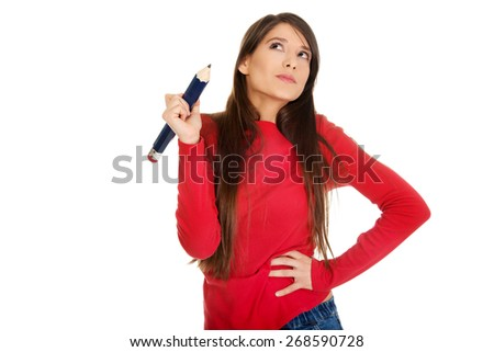 Beautiful young student woman with a big pencil. - stock photo