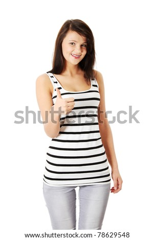 Beautiful young success woman giving thumbs up standing on white background.