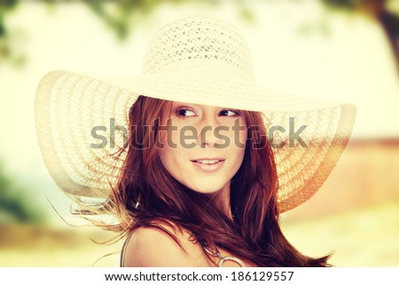 Beautiful young summer woman in hat