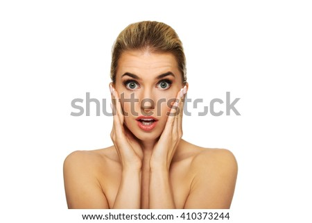 Beautiful young surprised woman - stock photo
