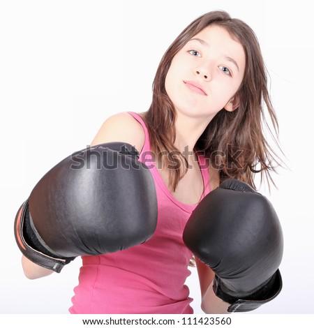 Beautiful young teen girl boxing - stock photo