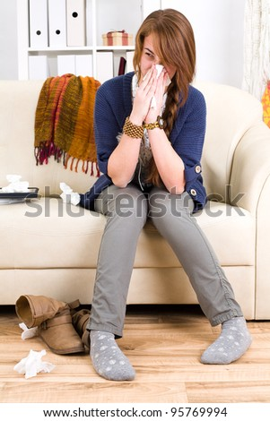 beautiful young teen girl ill at home - stock photo