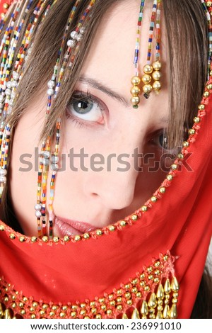 Beautiful young teenager posing in a belly dance costume