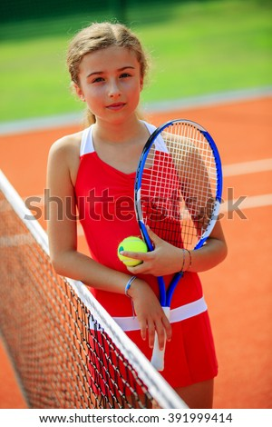 Beautiful young tennis player on the court. - stock photo