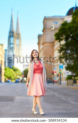 Beautiful young tourist walking in the street in Vienna, Austria - stock photo