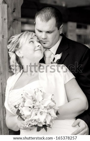 beautiful young wedding couple, bride looking to her groom, black and white tone