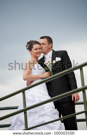 beautiful young wedding couple outdoor