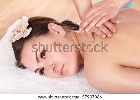Beautiful young white woman  having thai massage.