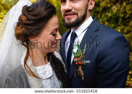 beautiful young wife and husband standing together in the park