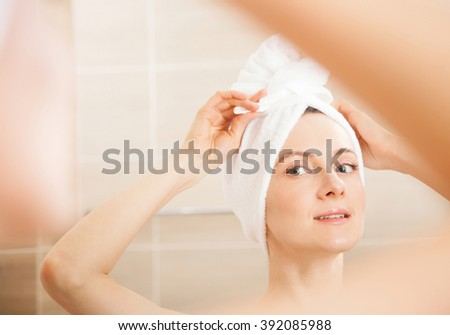 Beautiful young woman after morning shower - closeup portrait - stock photo