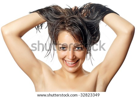 Beautiful young woman after shower with finger near chin