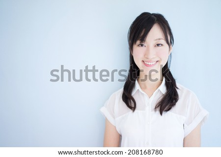 beautiful young woman against blue background