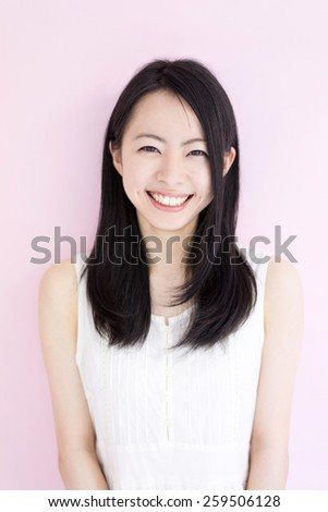 beautiful young woman against pink background - stock photo