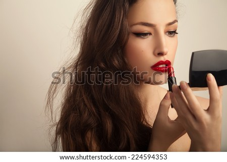 beautiful young woman apply red lipstick, beauty portrait