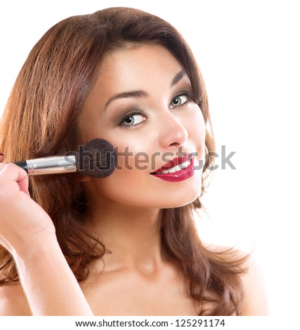 Beautiful Young Woman Applying Makeup. Brunette Girl Apply Make-up. Beauty Face. Isolated on White Background - stock photo