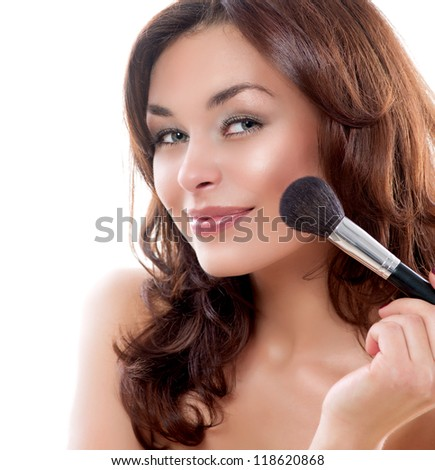 Beautiful Young Woman Applying Makeup. Make-up. Beauty Face. Isolated on White Background - stock photo