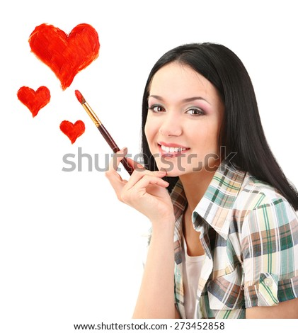 Beautiful young woman as painter with brush and red hearts isolated on white - stock photo