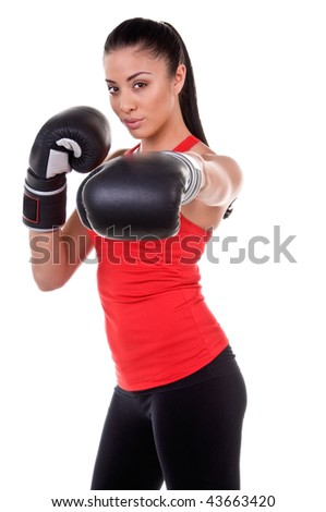 Beautiful young woman at a boxing workout in the gym - stock photo