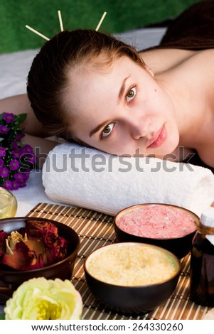 Beautiful young woman at a spa procedure - stock photo