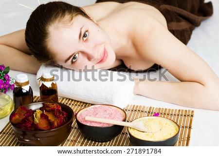 Beautiful young woman at a spa salon - stock photo