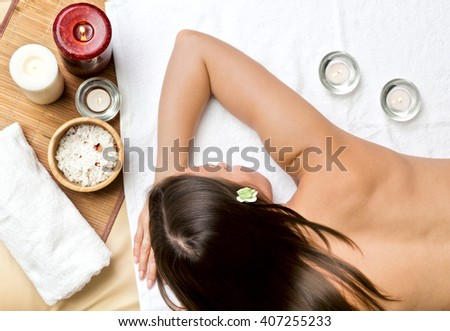 Beautiful young woman at a spa salon waits for massage