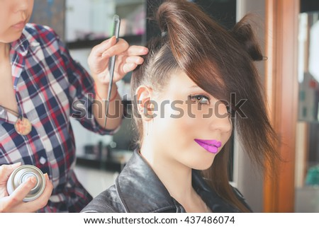 Beautiful young woman at beauty salon. Fashion hairstyle. Make up. Hair saloon. Stylish haircut, styling, fixing, straightening
