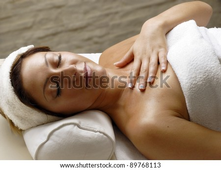 Beautiful young woman at beauty salon spa getting a body treatment.