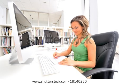 beautiful young woman at the office - stock photo