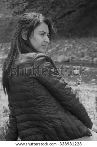 Beautiful young woman. Black and white portrait.