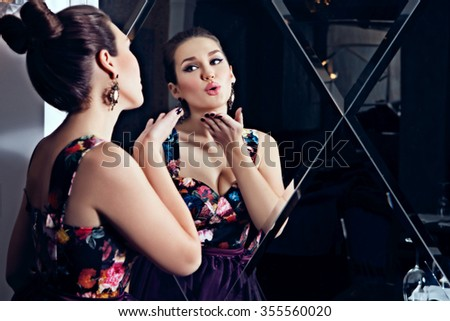 Beautiful Young woman blowing air kiss in mirror