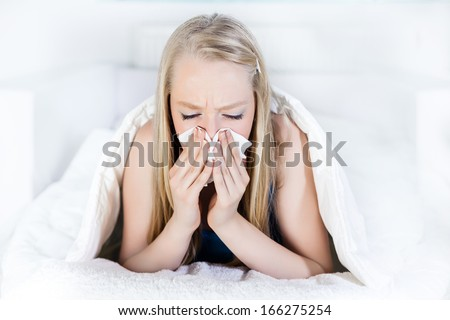 Beautiful Young Woman  blowing her nose with handkerchief