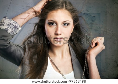beautiful young woman, blue eyes, brown hair, a gray jacket, white T-shirt - stock photo