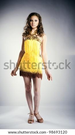 beautiful young woman, blue eyes, brown hair,yellow short dress gorgeous - stock photo